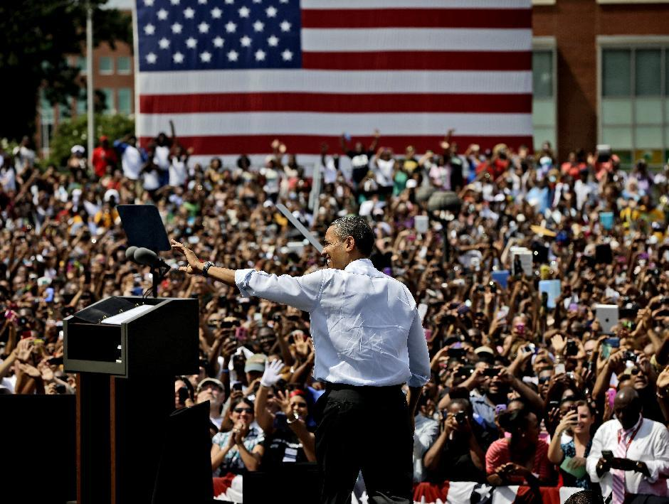 President Barack Obama waves to supporters as he takes the stage for  a campaign event at Norfolk State University, Tuesday, Sept. 4, 2012, in Norfolk, Va. (AP Photo/Pablo Martinez Monsivais)
