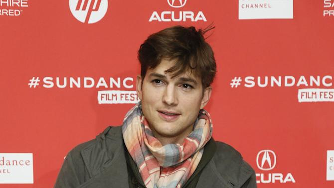 """Actor Ashton Kutcher, who portrays Apple's Steve Jobs in the film """"jOBS,"""" poses at its premiere during the 2013 Sundance Film Festival on Friday, Jan. 25, 2013 in Park City, Utah. (Photo by Danny Moloshok/Invision/AP)"""