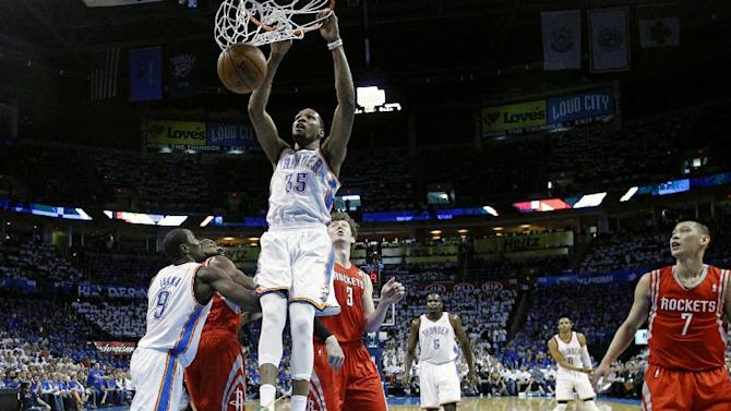 Oklahoma City Thunder forward Kevin Durant (35) shoots in front of Houston Rockets guard James Harden (13) and center Omer Asik (3) in the first quarter of Game 2 in their first-round NBA basketball playoff series in Oklahoma City, Wednesday, April 24, 2013. Oklahoma City won 105-102. (AP Photo/Sue Ogrocki)