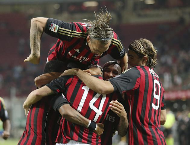 AC Milan midfielder Valter Birsa, covered by his teammates, of Slovenia, celebrates after scoring during the Serie A soccer match between AC Milan and Sampdoria at the San Siro stadium in Milan, Italy