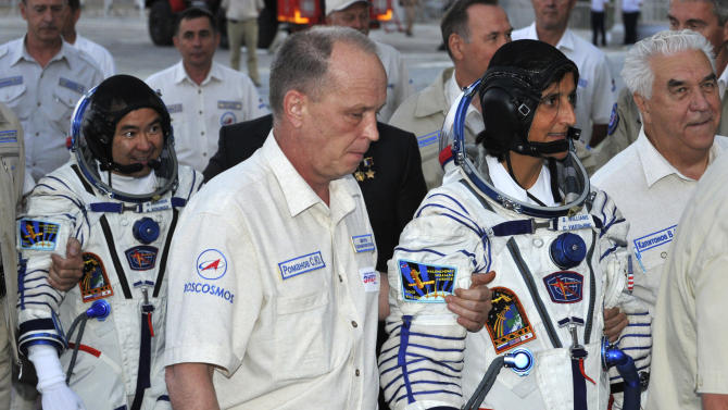 U.S. astronaut Sunita Williams, right, and Japanese astronaut Akihiko Hoshide,  crew members of the mission to the International Space Station, ISS, walk to the rocket prior to the launch of the Soyuz-FG at the Russian leased Baikonur cosmodrome, in Kazakhstan, Sunday, July 15, 2012.  (AP Photo/Vyacheslav Oseledko, Pool)