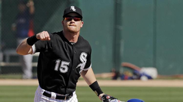 Chicago White Sox second baseman Gordon Beckham (15) watches his throw to first after forcing out Texas Rangers' Leonys Martin to start a double play in the fifth inning of a spring exhibition baseball game Tuesday, March 11, 2014, in Glendale, Ariz