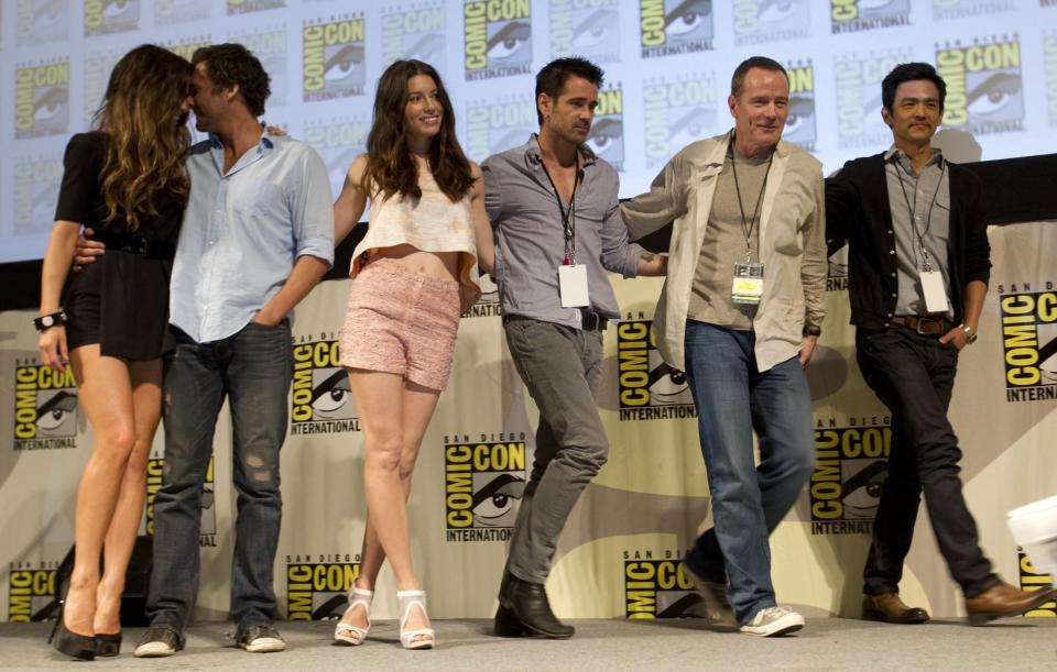 "Cast and crew members of the movie, ""Total Recall"" walk off stage during the Sony panel at Comic Con  Friday, July 22, 2011, in San Diego. They are, from left, Kate Beckinsale, Len Wiseman, Jessica Biel, Colin Farrell, Bryan Cranston, and John Cho. (AP Photo/Gregory Bull)"
