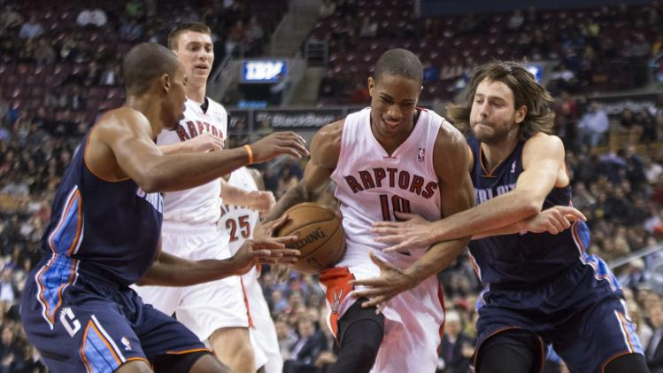 Walker hits OT winner, Bobcats top Raptors 104-102