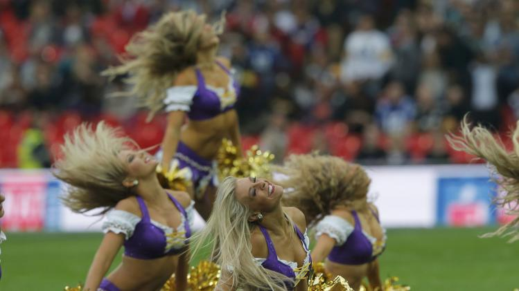 Minnesota Vikings cheerleaders perform before the Vikings met the Pittsburgh Steelers in their NFL football game at Wembley Stadium in London