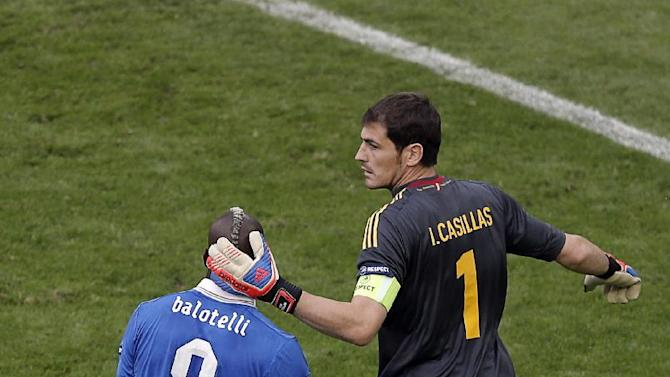 Spain goalkeeper Iker Casillas comforts Italy's Mario Balotelli during the Euro 2012 soccer championship Group C match between  Spain and Italy in Gdansk, Poland, Sunday, June 10, 2012. (AP Photo/Gero Breloer)