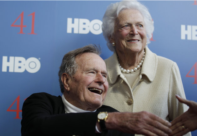 FILE - In a Tuesday, June 12, 2012 file photo, former President George H.W. Bush, and his wife, former first lady Barbara Bush, arrive for the premiere of HBO's new documentary on his life near the fa