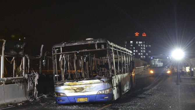 Chinese doubt police explanation of fatal bus fire