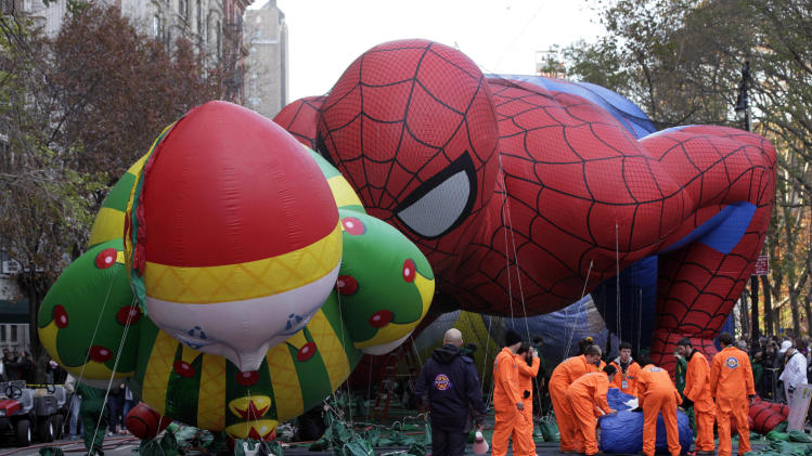 The Chloe ballon and Spider-Man balloon are inflated for the 86th annual Macy's Thanksgiving Day Parade on New York's Upper West Side,  Wednesday, Nov. 21, 2012. More than 3 million people typically attend the event and it has a TV audience of 50 million. (AP Photo/Richard Drew)
