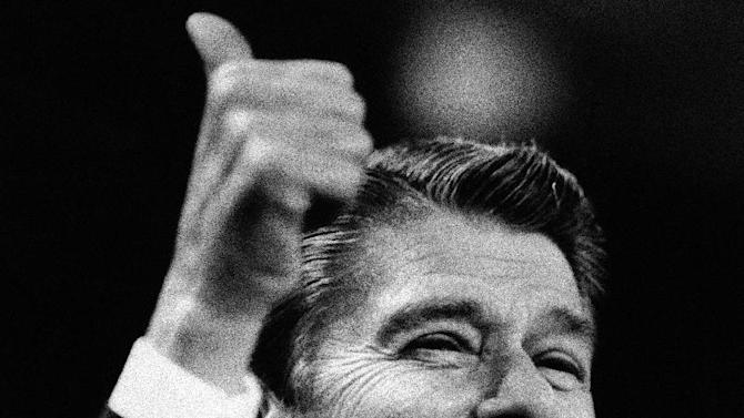 FILE - In this Aug. 23, 1984 black-and-white file photo, President Ronald Reagan gives the thumbs up gesture during his acceptance speech at the final session of the 1984 Republican National Convention in Dallas. Mitt Romney did not mention the war in Afghanistan, where 79,000 US troops are fighting, in his speech accepting the Republican presidential nomination on Thursday. The last time a Republican presidential nominee did not address war was 1952, when Dwight Eisenhower spoke generally about American power and spreading freedom around the world but did not explicitly mention armed conflict. Below are examples of how other Republican nominees have addressed the issue over the years, both in peacetime and in war.   (AP Photo/Peter Southwick, File)