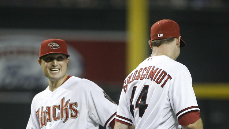 Arizona Diamondbacks' Jordan Pacheco, left, laughs as Paul Goldschmidt (44) replaces him at first base during a double switch in the eighth inning of a baseball game against the Pittsburgh Pirates, Friday, August 1, 2014, in Phoenix. The Pirates defeated the Diamondbacks 9-4. (AP Photo/ Ralph Freso)