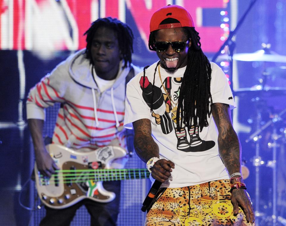 "Lil Wayne, right, performs during the Caesars Entertainment ""Escape To Total Rewards"" concert in Los Angeles, Thursday, March 1, 2012. Simultaneous concert events were held in New York, Chicago, New Orleans and Los Angeles. (AP Photo/Chris Pizzello)"