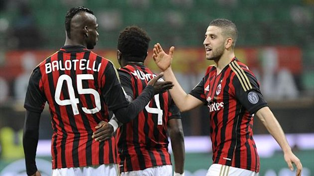 AC Milan's Mario Balotelli (L) celebrates with his teammates Sulley Muntari and Adel Taarabt (R) after scoring against Bologna (Reuters)