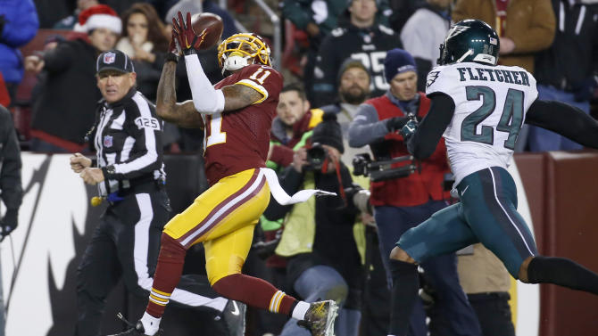 Washington Redskins wide receiver DeSean Jackson (11) pulls in a pass as Philadelphia Eagles cornerback Bradley Fletcher (24) closes in during the second half of an NFL football game in Landover, Md., Saturday, Dec. 20, 2014. (AP Photo/Alex Brandon)