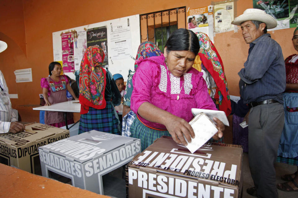 A woman casts her ballot at a polling station in Oaxaca, Mexico, Sunday, July 1, 2012. Mexico's more than 79 million voters head to the polls Sunday to elect a president, who serves one six-year term, as well as 500 congressional deputies and 128 senators. (AP Photo/ Luis Alberto Cruz)