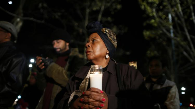 Kay Benjamin, whose daughter lives in South Africa, participates in a candlelight vigil in memoriam of Nelson Mandela's death, in Los Angeles