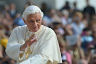 "Pope Benedict XVI, pictured as he waves to pilgrims after arriving at St Peter's square for his weekly general audience, on October 17, at the Vatican. The Pope has named seven new saints including the first Native American, marking the start of a ""Year of Faith"" aimed at countering the rising tide of secularism in the West"