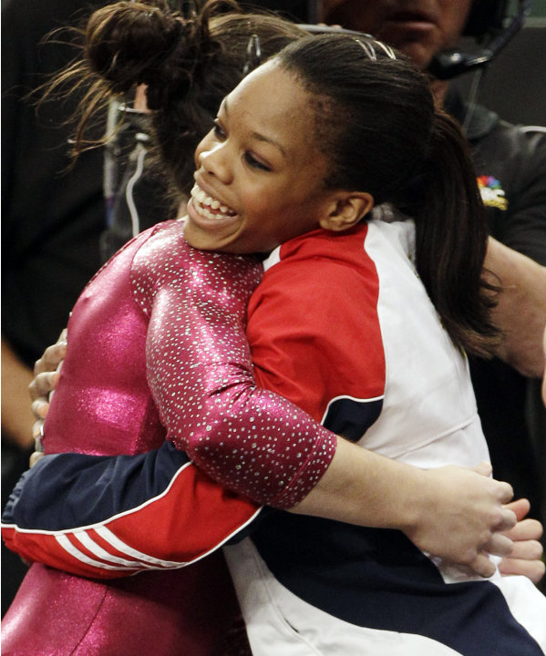 Gabrielle Douglas, right, who competed as an alternate, embraces teammate Alexandra Raisman at the conclusion of the American Cup gymnastics meet at New York's Madison Square Garden, Saturday, March 3
