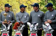 American Ryder Cup Team member Tiger Woods (2nd L) talks with Captain Davis Love III (L), Keegan Bradley (2nd R) and Dustin Johnson (R) at Medinah Country Golf Club in Medinah, Illinois, ahead of the 39th Ryder Cup