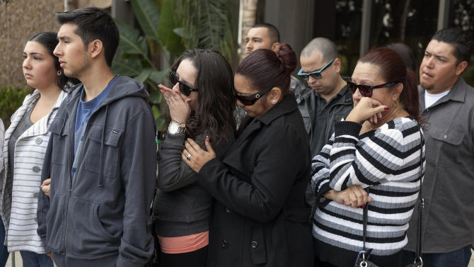 Unidentified supporters and family members of victim, 31-year-old Phillip Moreno, express their support for their relative outside court in Torrance, Calif., Tuesday, Nov. 27, 2012. Moreno was struck late Saturday by a car driven by Sherri Wilkins. Los Angeles County prosecutors have filed murder and drunken-driving charges against Wilkins, a substance abuse counselor, who allegedly struck Moreno and drove for more than two miles with the dying victim on the hood of her car. Moreno died at a hospital. (AP Photo/Damian Dovarganes)