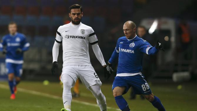 PAOK Salonika's Alexandros Tziolis chases Dinamo Minsk's Nenad Adamovic during their Europa League soccer match at the Borisov Arena outside Minsk