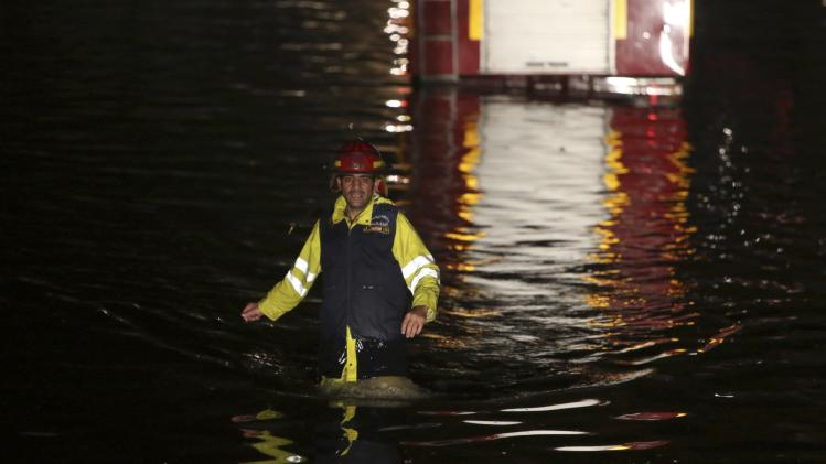 A Civil Defence worker makes his way through a flooded tunnel leading to Beirut airport after heavy rainfall