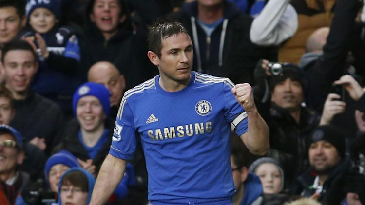 Chelsea's Frank Lampard celebrates his goal against West Ham United during their English Premier League soccer match at Stamford Bridge, London, Sunday, March 17, 2013. (AP Photo/Sang Tan)