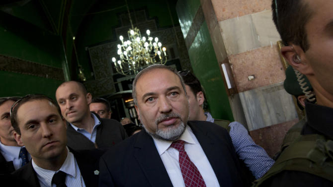 Israel's former Foreign Minister Avigdor Lieberman, center, visits the site known to Jews as the Tomb of the Patriarchs, and to Muslims as the Ibrahimi Mosque, in the West Bank city of Hebron, Monday, Jan. 14, 2013. Lieberman indicated on Monday that he would quit politics if convicted in his breach of trust and fraud case. (AP Photo/Bernat Armangue)