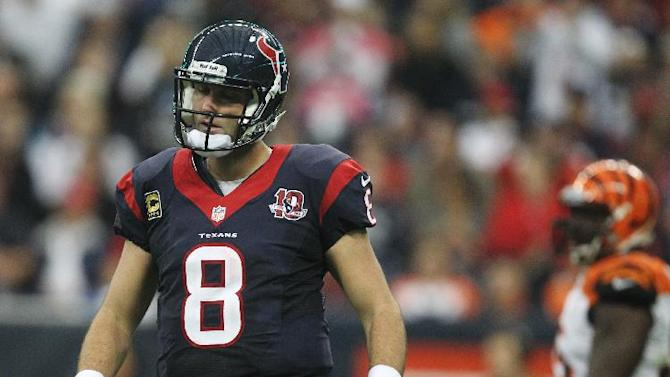 Houston Texans quarterback Matt Schaub walks off the field after throwing an interception to Cincinnati Bengals' Leon Hall during the second quarter of an NFL wild card playoff football game Saturday, Jan. 5, 2013, in Houston.  (AP Photo/Patric Schneider)