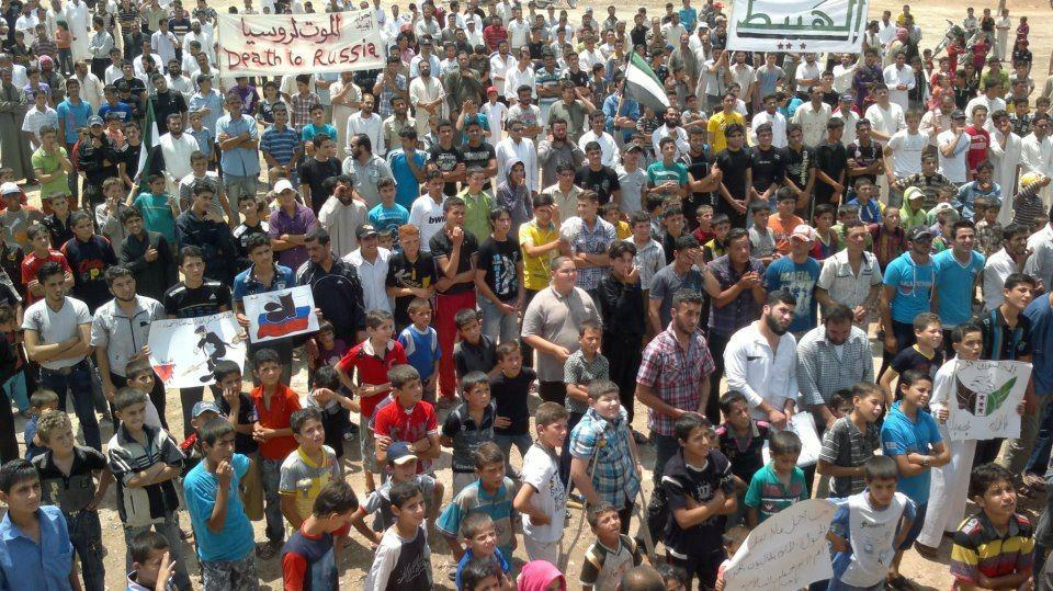 In this citizen journalism image taken on Friday, June 15, 2012 and provided by Edlib News Network ENN, Syrians chant slogans during a demonstration in Idlib province, northern Syria. (AP Photo/Edlib News Network ENN) THE ASSOCIATED PRESS IS UNABLE TO INDEPENDENTLY VERIFY THE AUTHENTICITY, CONTENT, LOCATION OR DATE OF THIS HANDOUT PHOTO