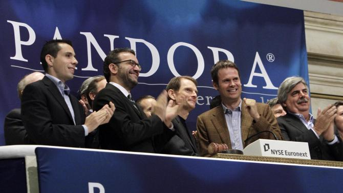 FILE - In this file photo taken June 15, 2011, Joe Kennedy, third from left, CEO & President, and Tim Westergren, fourth from left, Chief Strategy Officer & Founder, of Pandora internet radio, ring the NYSE opening bell to celebrate their company's IPO at the New York Stock Exchange. Here's something to keep in mind for those worried that we're in another tech stock bubble: We're still nowhere close to the giddy days of the late 1990s and early 2000 when investors bought stocks as impulsively as lottery tickets. Technology stocks are trading at their cheapest prices in more than nine years.  (AP Photo/Richard Drew, file)