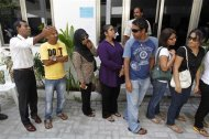 Maldivian presidential candidate Mohamed Nasheed (L), who was ousted as president in 2012, stands in a line to cast his vote during the presidential elections in Male September 7, 2013. REUTERS/Dinuka Liyanawatte