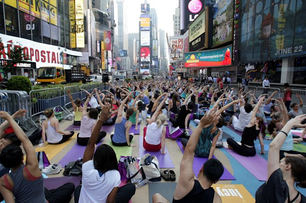 Thousands Practice Yoga in Times Square to Mark the Summer Solstice in New York City, USA
