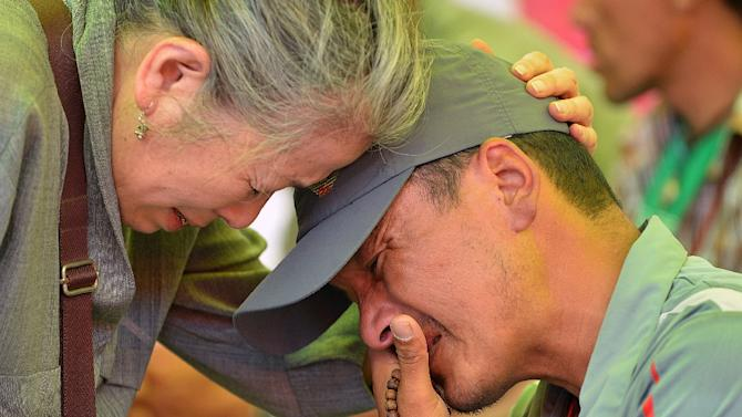 Nima Lama (R) cries during a Buddhist ceremony at the Yellow Gumba in Kathmandu