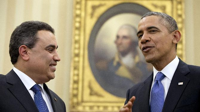 President Barack Obama talks with Tunisian Prime Minister Mehdi Jomaa, Friday, April 4,2014, in the Oval Office of the White House in Washington. (AP Photo/Carolyn Kaster)