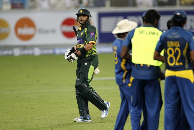 Pakistan's Afridi walks back after being dismissed during their second Twenty20 international cricket match against Sri Lanka in Dubai