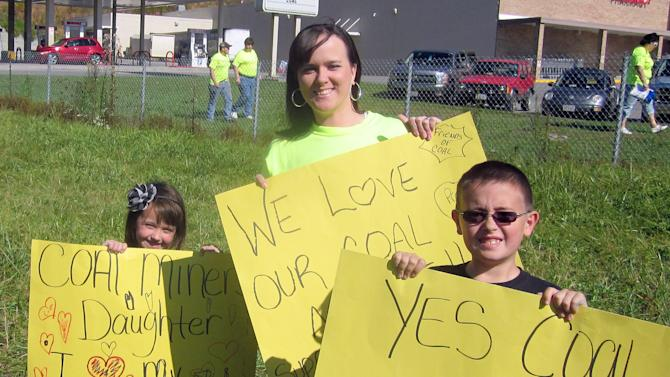 In a Saturday Oct. 13, 2012 photo, Amanda McCracken, of Big Stone Gap, stands with her children, Kaylee, 6, and Pryston, 8, at Saturday's United for Coal demonstration in support of her husband and their father, who is a coal miner.  Only a few generations ago, coal miners were literally at war with their employers, spilling and shedding blood on West Virginia's Blair Mountain in a historic battle for union representation and fair treatment.  Today, their descendants are allies in a carefully choreographed rhetorical war playing out across eastern Kentucky, southwestern Virginia and all of West Virginia. It's fueled by a single, unrelenting message that they now face a common enemy _ the federal government _ that has decided that coal is no longer king, or even noble. (AP Photo/Bristol Herald Courier, Allie Robinson)