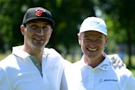 MUNICH, GERMANY - JUNE 19:  Boxer Wladimir Klitschko and Ernie Els pose for a picture during pro am ahead of the BMW International Open at Golfclub Munchen Eichenried on June 19, 2013 in Munich, Germany.  (Photo by Warren Little/Getty Images)