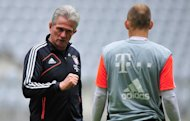 MUNICH, GERMANY - MAY 14:  Head coach Jupp Heynckes (L) of Muenchen talks to Arjen Robben during a training session during the UEFA Champions League Finalist Media Day at Allianz Arena on May 14, 2013 in Munich, Germany.  (Photo by Lennart Preiss/Bongarts/Getty Images)