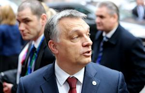 Hungarian Prime Minister Viktor Orban, center, arrives …