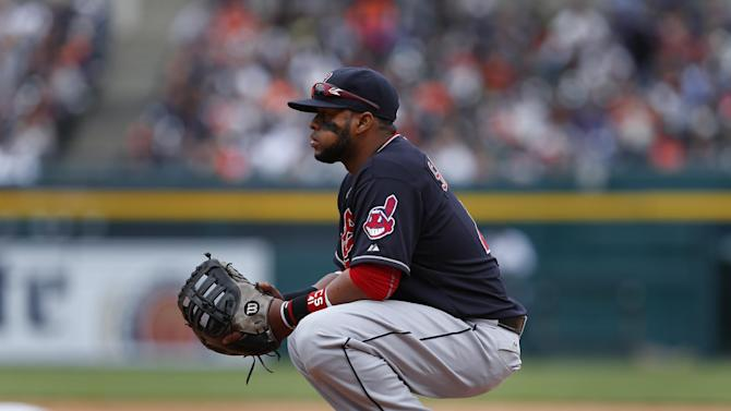 Cleveland Indians first baseman Carlos Santana waits for a play against the Detroit Tigers in the fifth inning of a baseball game in Detroit Sunday, April 26, 2015. (AP Photo/Paul Sancya)