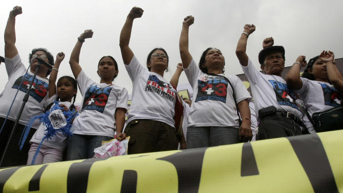 Relatives of the 43 health workers arrested and jailed, shout slogans during a rally to mark the 62nd anniversary of the United Nations Declaration of Human Rights at Mendiola near the Presidential Palace Friday Dec. 10, 2010 in Manila, Philippines. Philippine President Benigno Aquino III ordered prosecutors Friday to drop criminal charges against 43 health workers arrested by the army as suspected communist rebels 10 months ago, saying their rights were violated. (AP Photo/Bullit Marquez)