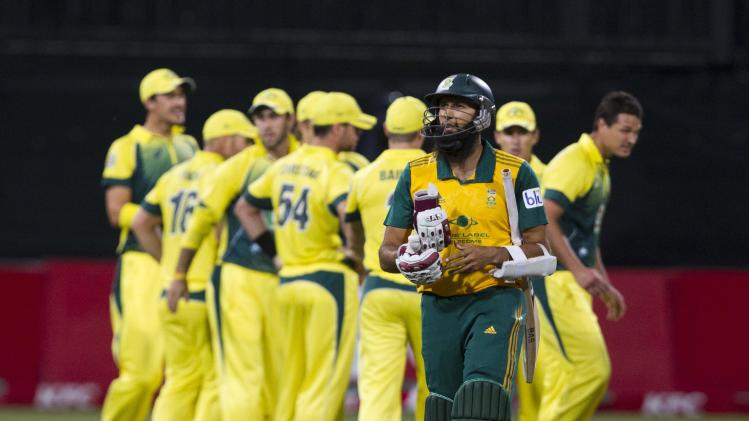 South Africa's Amla leaves the field after getting out during the cricket T20 International cricket match against Australia in Durban
