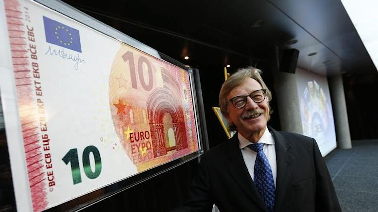 Mersch, Member of the Executive Board of the European Central Bank presents an oversized newly unveiled 10 euro note at the headquarters of the European Central Bank (ECB) in Frankfurt