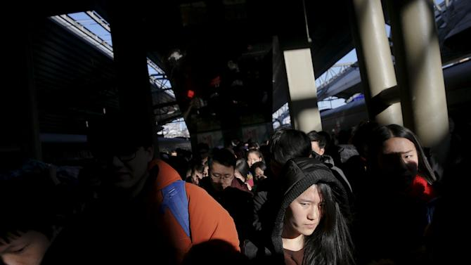 Passengers walk on platform of the Beijing Railway Station after arriving by train to China's capital during the Chinese Lunar New Year travel rush as annual Spring Festival holidays end