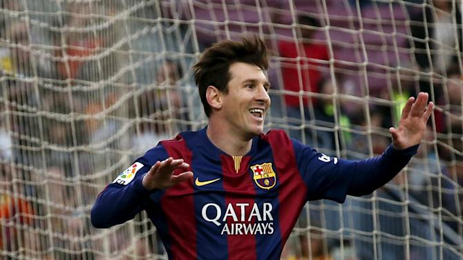 Barcelona's Lionel Messi celebrates his goal against Getafe during their Spanish first division soccer match at Nou Camp stadium in Barcelona