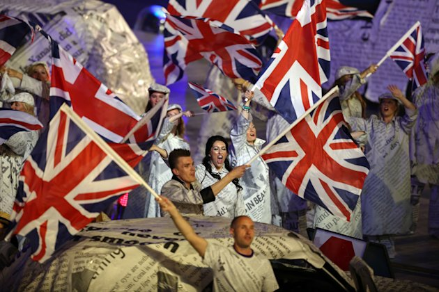 Performers wave the British flag during the Closing Ceremony at the 2012 Summer Olympics, Sunday, Aug. 12, 2012, in London. (AP Photo/Sergei Grits)