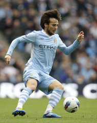 Manchester City's David Silva controls the ball as his team defeated Wolverhampton Wanderers 3-1 in their English Premier League soccer match at The Etihad Stadium, Manchester, England, Saturday Oct. 29, 2011. (AP Photo/Jon Super)