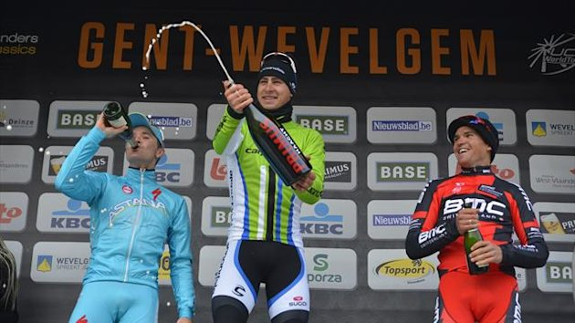 Second Slovenian Borut Bozic of Pro Team Astana, winner Slovakian Peter Sagan of Liquigas-Cannondale and third placed Belgian Greg Van Avermaet of BMC Racing Team celebrate with champagne on the podium after the 75th edition of the Gent-Wevelgem (AFP)
