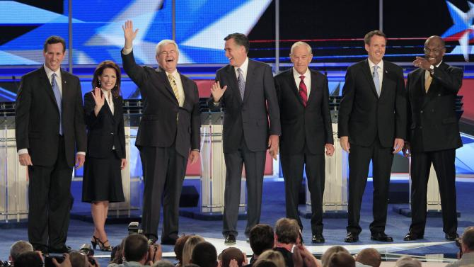 From left, former Pennsylvania Sen. Rick Santorum, Rep. Michele Bachmann, R-Minn., former House Speaker Newt Gingrich, former Massachusetts Gov. Mitt Romney, Rep. Ron Paul, R-Texas, former Minnesota Gov. Tim Pawlenty and businessman Herman Cain stand on stage before first New Hampshire Republican presidential debate at St. Anselm College in Manchester, N.H., Monday, June 13, 2011. (AP Photo/Jim Cole)